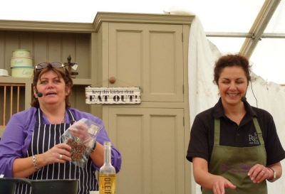 Jane cooking new Premium Black Pudding with Chef, Rachel Green